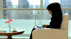Female business Gulf Region technology tablet real estate development property Stock Footage