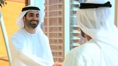 handshake Emirates UAE business male city hotel travel finance banking meeting - stock footage