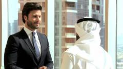 handshake European Middle Eastern business Dubai real estate property meeting - stock footage