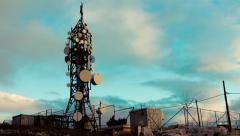 4K big tall communication tower with blue sky and clouds background timelapse Stock Footage