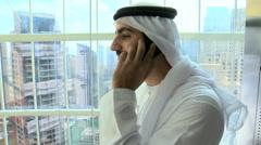 Arabic male business travel elevator banking finance technology smart phone Stock Footage