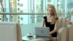 blonde female Western Caucasian business finance traveller technology laptop - stock footage