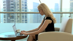 blonde female Western Caucasian business finance traveller technology tablet - stock footage