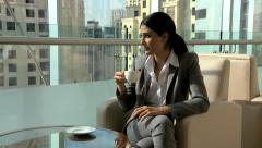 female brunette Western Caucasian business traveller finance banking coffee - stock footage