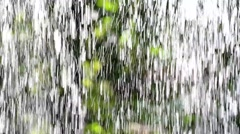 reflection of drizzle in the sunlight - stock footage