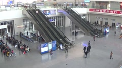 Busy people in the waiting room of east railway station in Chengdu,Sichuan,China Stock Footage