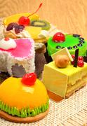 Assortment of delicious cakes, pies, tarts with fuits and cream Stock Photos