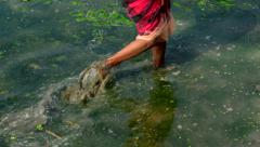 Indian village women walking over the water for collecting crab. Stock Footage