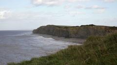 Cliffs, grass and beach Somerset, Kilve, hiking Stock Footage