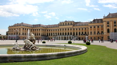 WIEN SCHONBRUNN PALACE MAIN ENTRANCE LS 1 FOUNTAIN PULL Stock Footage