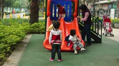 The children are playing on the slide, very happy Stock Footage