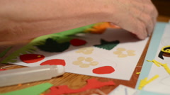 To craft. sorting strawberry leave, fruits and flower heads of cardbox paper Stock Footage