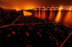 Ireland, Munster, County Cork, Crosshaven, Glowing townscape at night Stock Photos