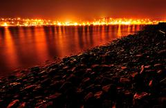 Ireland, Munster, County Cork, Crosshaven, Glowing townscape at night - stock photo