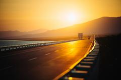 View of empty road at sunset Stock Photos