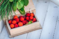 Wooden box of lychee fruit Stock Photos