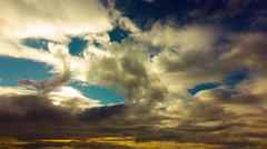 4K colorful golden sunset sky time lapse mountain clouds Stock Footage