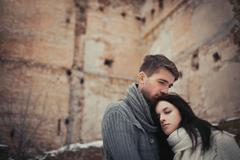 Couple in front of ruined building in winter Stock Photos