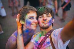 Young man and teenage girl (16-17) on Holi Fest - stock photo