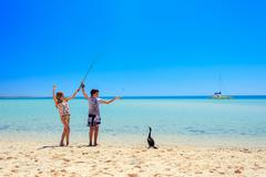 Austral, Western Austral, Children fishing in Shark Bay Stock Photos