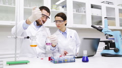 Young scientists making test or research in lab Stock Footage