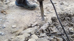 Using Jackhammer On A Rock Stock Footage