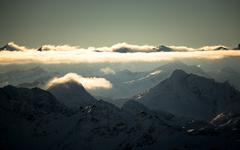 Austria, Alpine peaks in golden clouds Stock Photos