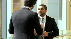 handshake Middle Eastern American business male real estate property development - stock footage