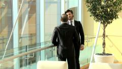 Handshake Western Caucasian Arabic male business city buildings insurance growth Stock Footage