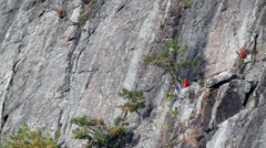 Rock climbers on ledge Stock Footage