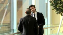 Handshake multi ethnic business male stocks shares trading markets broker Stock Footage