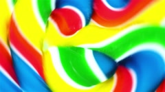 Close view of a vibrant lollypop spinning fast in circles - stock footage