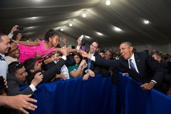 President Barack Obama stretches to shake the hand of a little girl during a  Free Stock Photos
