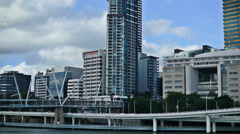 Kurilpa Bridge and Brisbane skyscrapers TL 4K Stock Footage