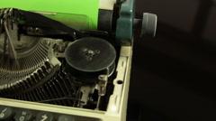 Closeup slider shot of vintage typewriter with green paper Stock Footage