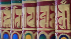 Buddhist religious prayer wheels in Tibetan monastery in the Dharamsala, India Stock Footage