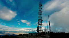 4K big tall communication towers with blue sky and clouds background Stock Footage