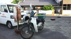 Small Motorbike Parked In Japanese Village Next To Van 4K Stock Footage