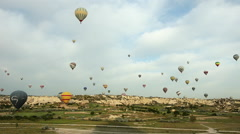 Cappadocia hot air balloons flight, tour, journey, color, hoodoo, time lapse Stock Footage