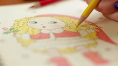 Painting of cartoon blonde girl with yellow pancil - stock footage