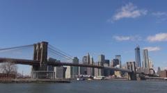 Timelapse Brooklyn Bridge cruise ship travel Hudson River Manhattan New York USA Stock Footage