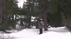 Snowshoer hikes a winter trail Stock Footage