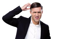 Portrait of a funny businessman over white background Stock Photos