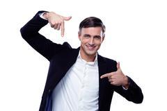 Businessman in formalwear gesturing finger frame over white background Stock Photos