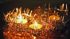 Christmas candles burn among fir-tree tinsel Stock Footage