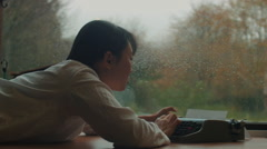 Asian woman typing Stock Footage
