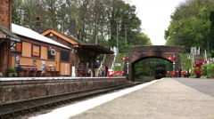 Steam train 5542 pulls into Bishops Lydeard station Somerset Stock Footage