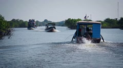 Tonle sap lake, cambodia - circa dec 2013: colorful, handmade, wooden passeng Stock Footage