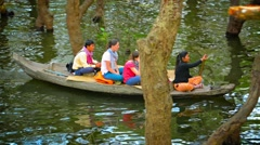 Tonle sap lake, cambodia - circa dec 2013: tourists occupy two rowboats as th Stock Footage