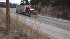 Big rig cattle truck on freeway, mountain tavel - stock footage